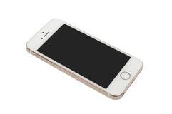 IPhone 5S del oro de Apple Imagen de archivo libre de regalías