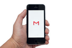 IPhone 5S with Gmail app. PAVLOGRAD, UKRAINE - OCTOBER 21, 2014: Photo of a hand using linkedIn app on iphone 5S. Gmail app - free officaial app from google mail Stock Images