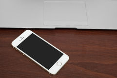 IPhone 5s Gold wit silver laptop Royalty Free Stock Images