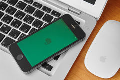 iPhone 5s with mobile application for Evernote on the screen Stock Photo