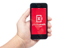 IPhone 5s with PhotoMath app Stock Photo