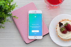 IPhone 6S Rose Gold with app Twitter on the table. Alushta, Russia - October 25, 2015: iPhone6S Rose Gold with app Twitter on the table. iPhone 6S Rose Gold was Stock Images