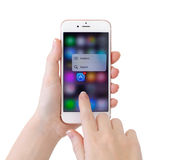 IPhone 6S Rose Gold mit Musik der Noten-3D und Apples Stockfotografie