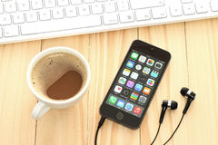 IPhone 5s Space Gray with coffee and keyboard on wooden background Royalty Free Stock Photography