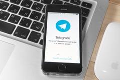 IPhone 5s with Telegram app Stock Photo