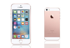 Iphone se. Rose Gold. IPhone is a front view and back view on isolated white background stock illustration