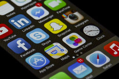 Iphone social network apps. Originally built in Iphone apps on the screen with social network apps Stock Images