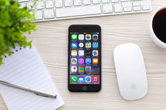 IPhone 6 Space Gray with apps on screen Stock Photos