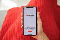 IPhone X with streaming video YouTube Premium on the screen stock images
