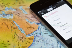 Iphone with travel application on map of Middle East Stock Photography