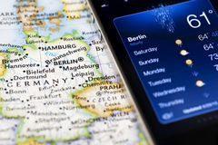 Iphone with weather application on map of Berlin Royalty Free Stock Image