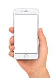 IPhone 6 in woman hand. White iPhone 6 in woman hand royalty free stock photos
