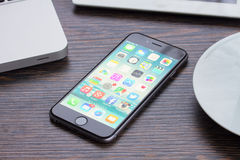 Iphone 6 on working table Stock Photos