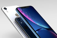 3 iPhone XR blue. silver and Space Grey smart phones royalty free stock images