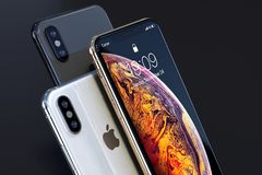 IPhone Xs Gold, Silver and Space Grey composition close-up. IPhone Xs Gold, Silver and Space Grey, on a dark background. Front and back sides visible. Concept royalty free stock photography