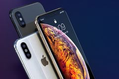 IPhone Xs Gold, Silver and Space Grey composition close-up stock photos