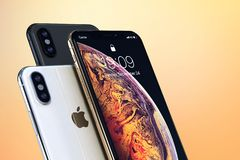 IPhone Xs Gold, Silver and Space Grey on light colors. IPhone Xs Gold, Silver and Space Grey, on a light colorful background. Front and back sides visible stock photo