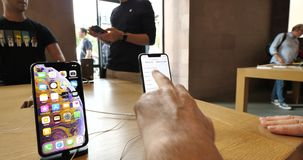 IPhone Xs and Xs max testing new specifications data and display size. STRASBOURG, FRANCE - SEP 21, 2018: Handheld video of senior man hands POV testing stock footage
