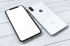 IPhone Xs Silver mock-up composition on white wood. IPhone Xs Silver on a white wood background. Front and back sides visible. Concept composition. Ideal for royalty free stock image