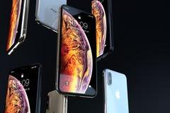 IPhone Xs złoto, srebro i przestrzeni Siwieję spada puszek, obrazy stock