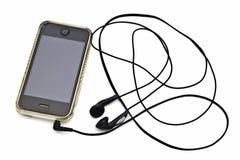 Iphone y auricular fotos de archivo