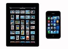 iphone4s查出的2个苹果ipad 图库摄影