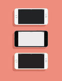 3 IPhones. On a colored background Stock Photography