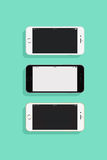 3 IPhones. On a colored background Royalty Free Stock Photo