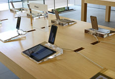 IPhones displayed in an apple store. IPhones  displayed on a table in an apple store Royalty Free Stock Photos