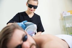 IPL therapy at men`s back Royalty Free Stock Photography