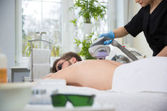 IPL therapy at men`s back Royalty Free Stock Image