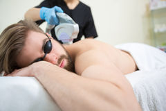 IPL therapy at men`s back Stock Photography