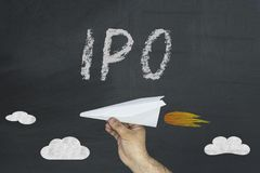 IPO Initial Public Offering. Finance business concept on green blackboard Stock Photos