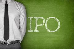 IPO or Initial public offering text. On blackboard with businessman on side Royalty Free Stock Photography