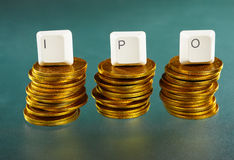 IPO letter on gold coins stack Royalty Free Stock Photos