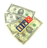 IPO Wooden Blocks on American Dollars. Wooden blocks with letters I, P, and O on five US dollar bills Stock Photo