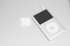IPod classic 160 Gb on macbook. Pavlograd, Ukraine - December 18, 2014: iPod classic 160 Gb on silver macbook. Studio shot Stock Photo