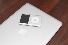 IPod classic 160 Gb on macbook. Pavlograd, Ukraine - December 18, 2014: iPod classic 160 Gb on silver macbook. Studio shot Royalty Free Stock Photos