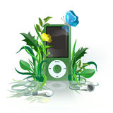 IPod green. Green iPod with earphones in grass Stock Images