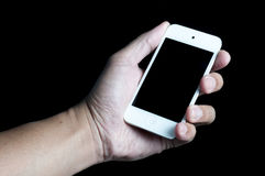 Ipod on hand. Handhold ipod on black back ground Royalty Free Stock Images