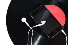 Ipod and music. An old record settle as a background and an ipod over it Stock Photography