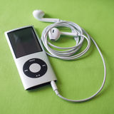 IPod Nano with Earpods. BERRY, AUSTRALIA - June 23 2016 : An Apple  iPod Nano 4th generation, in silver,  with Apple Earpods attached Royalty Free Stock Photos