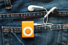 IPod Shuffle. With earphones in jeans pocket Royalty Free Stock Photo
