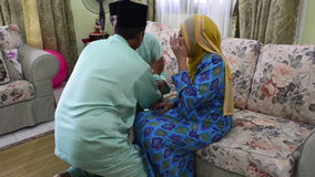 IPOH, MALAYSIA, Circa July 2015 - A Muslim family asking forgiveness in the morning of Eid Ul Fitr . stock video