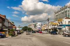 Street with stores and colonial buildings in town of Ipoh in Malaysia. Ipoh, Malaysia - December 11, 2017: Traffic on the street with stores and colonial royalty free stock photography