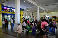Passengers wait inside the departure hall of the railway train station Ipoh Malaysia royalty free stock image