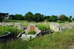 General view of large Chinese graveyard cemetery with graves and tombstones Ipoh Malaysia. Ipoh, Malaysia - June 3, 2017: A view of an expansive graveyard for royalty free stock image