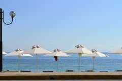 Ipsos Beach in Corfu parasols and lamp Royalty Free Stock Photography