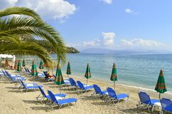 Ipsos Beach in Corfu sun loungers Stock Image