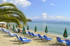 Ipsos Beach in Corfu sun loungers. Sun loungers on Ipsos Beach in Corfu a Greek island in the Ionian sea Stock Image